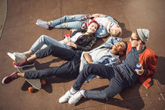 High angle view of teenagers group lying together and resting Royalty Free Stock Images