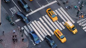High Angle View of Traffic and Pedestrians Along 5th Avenue in Manhattan. 9461 NEW YORK CITY - Circa October, 2017 - A high angle view of traffic and pedestrians stock video