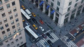 High Angle View of Traffic and Pedestrians on 5th Avenue in Manhattan. 9454 NEW YORK CITY - Circa October, 2017 - A high angle view of pedestrians and traffic on stock video footage