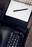 High angle view of typewriter by fountain pen on open diary Stock Photo