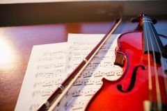 High angle view of violin with sheet music Royalty Free Stock Photography