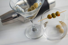 High angle view of vodka martini with cocktail shaker. On wooden table Royalty Free Stock Photo