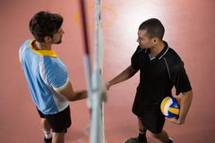 High angle view of volleyball players giving handshake Royalty Free Stock Photo