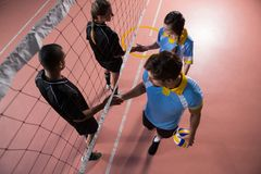 High angle view of volleyball players shaking hands Stock Photos