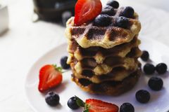 Waffles and berries on plate in close royalty free stock images