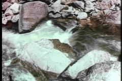High angle view of water flowing through rocks in river stock video