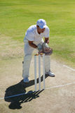 High angle view of wicketkeeper standing behind stumps on field Royalty Free Stock Photo