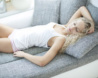 High angle view of woman sleeping on sofa at home Royalty Free Stock Images