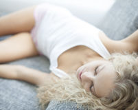 High angle view of woman sleeping on sofa at home Royalty Free Stock Photo