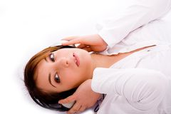High angle view of woman tuned to music lying down Royalty Free Stock Photo