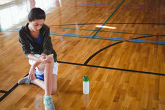 High angle view of woman using mobile phone in basketball court Royalty Free Stock Image