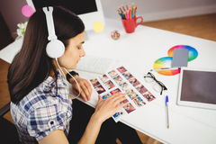 High angle view of woman viewing photographs Royalty Free Stock Photo