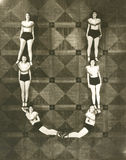 High angle view of women forming the letter U Royalty Free Stock Image