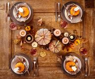 Table set four four with pumpkins Royalty Free Stock Photo
