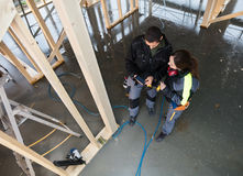 High Angle View Of Workers With Digital Tablet At Site. High angle view of male and female workers with digital tablet standing at construction site Royalty Free Stock Photos