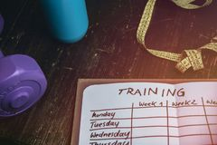 High Angle View Of A Workout Plan In Notebook At Wooden Desk stock images
