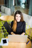 High angle view of an young brunette working at her office desk with laptop. Businesswoman working in office. High angle view of an young brunette working at her Royalty Free Stock Photography