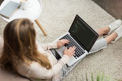 high angle view of young female developer coding with laptop stock image