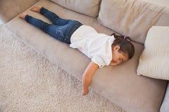 High angle view of a young girl sleeping on sofa Stock Photos
