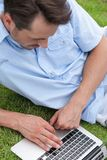 High angle view of young man using laptop in park Stock Photography