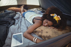 High angle view of young woman sleeping by tablet Stock Images