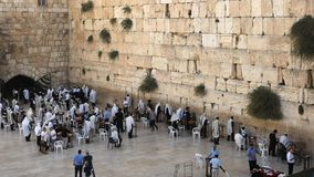 High angle wide view of the wailing wall wide in jerusalem. High angle wide view of jewish men praying and worshiping at the wailing wall in jerusalem, israel stock video footage