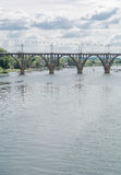 High arched railway bridge made of concrete across the Dnieper River in the city Dnepropetrovsk. Royalty Free Stock Images