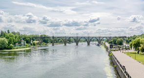 High arched railway bridge made of concrete across the Dnieper River in the city Dnepropetrovsk. Royalty Free Stock Photos