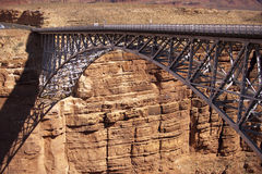 High arched steel bridge traversing gorge Stock Image