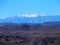 High ATLAS MOUNTAINS range landscape in central MOROCCO in Africa. High ATLAS MOUNTAINS range landscape in central MOROCCO seen from location near Ouarzazate Royalty Free Stock Images