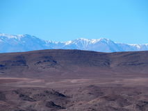 High ATLAS MOUNTAINS range landscape in central MOROCCO in Africa. High ATLAS MOUNTAINS range landscape in central MOROCCO seen from location near Ouarzazate Royalty Free Stock Photography