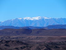 High ATLAS MOUNTAINS range landscape in central MOROCCO in Africa. High ATLAS MOUNTAINS range landscape in central MOROCCO seen from location near Ouarzazate Stock Photography