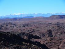 High ATLAS MOUNTAINS range landscape in central MOROCCO in Africa. High ATLAS MOUNTAINS range landscape in central MOROCCO seen from location near Ouarzazate Royalty Free Stock Photo