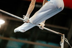 High bar male gymnast. To competition in artistic gymnastics Stock Image