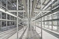 High bay stock with metal regales. New building lot of high bay stock with steel shelves stock image