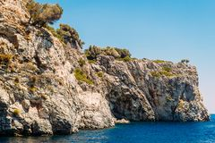 High beautiful cliffs of Turkey, blue sea, sea excursions. In summer stock photography