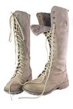 High beige boots. With laces on the white background Stock Images