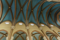 High beige columns and vaulted blue ceiling. In the Christian church Stock Images