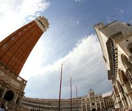 High Bell Tower of St. Mark and the big St. Mark square with fis Royalty Free Stock Photo