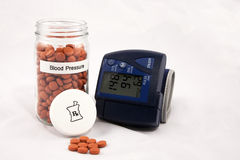 High Blood Pressure. Vial of pills labelled Blood Pressure with a blood pressure cuff Stock Photos