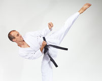 High blow mawashi geri is beating sportsman Stock Photography