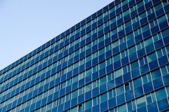 A high blue glass office building Stock Photo