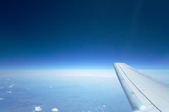 High blue sky wing Stock Photo