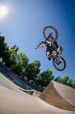 High BMX jump. In a skate park Royalty Free Stock Image