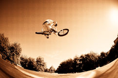 High BMX jump. In a skate park Royalty Free Stock Photos