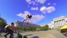 High BMX jump in a skate park. Sport. Motion biker jumps. Young boy jumping with his BMX Bike at skate park. bmx bicycle stock video footage