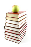 High books pyramid with green apple on top Royalty Free Stock Photos