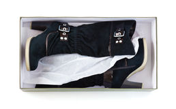 High boots in a box Royalty Free Stock Photo