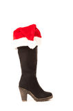 High boots with christmas hats Stock Photos