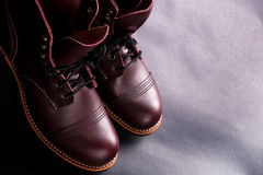 High boots. Fashionable mens leather brown shoes on light black background.  Top view. Copy space. Royalty Free Stock Image